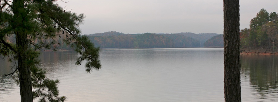 CARTERS LAKE IS 3200 ACRES, AND HAS NO PRIVATE DOCKS OR DEVELOPMENT ALONG 62 MILES OF NATURAL SHORELINE. IT IS MORE THAN 450 FEET DEEP WITH THE TALLEST EARTHEN DAM EAST OF THE MISSISSIPPI RIVER.